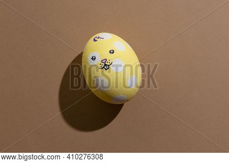 Happy Easter. Funny Bunny Decor. Holiday Celebration. Festive Gift Card. Yellow Egg With White Spott