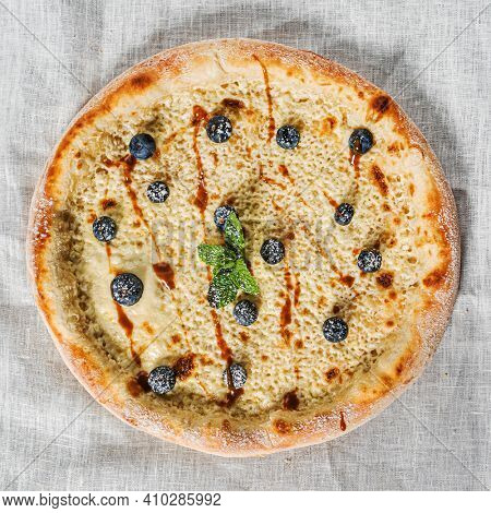 sweet pizza with bluberries and caramel