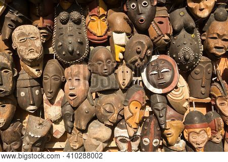 Traditional African Masks Hanging For Sell In A Market Stall