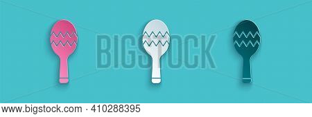 Paper Cut Maracas Icon Isolated On Blue Background. Music Maracas Instrument Mexico. Paper Art Style