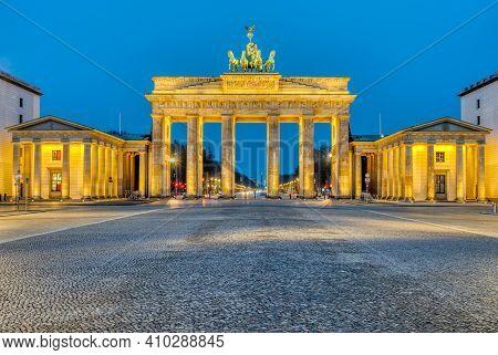 The Famous Illuminated Brandenburg Gate In Berlin At Dawn