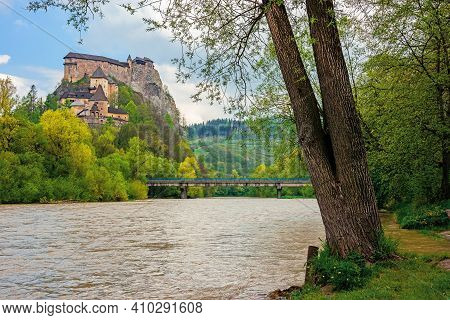 Oravsky Podzamok, Slovakia - May 01, 2019: Oravsky Castle On The Hill Near The River. Popular Travel