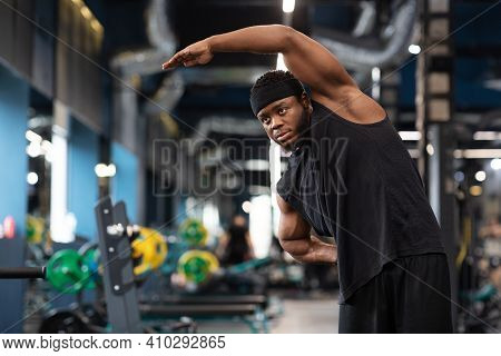 Warm Up, Limber Up, Stretching Concept. Handsome African American Bearded Sportsman Stretching His M