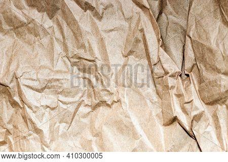 Crumpled Kraft Paper Background. Kraft Design Texture