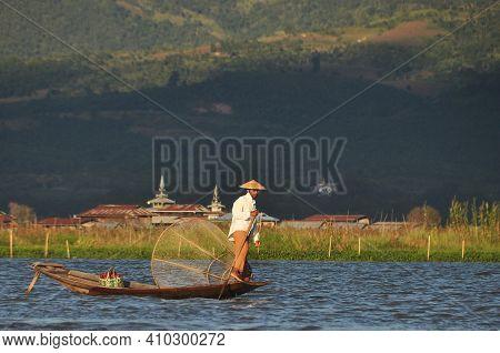 Inle, Myanmar - November 29, 2015: Fisherman Sailing On Lake In Mountains, View Of Traditional Orien