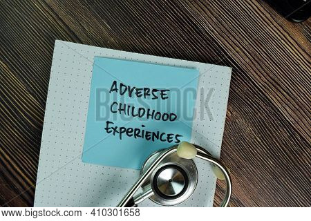 Adverse Childhood Experiences Write On Sticky Notes Isolated On Wooden Table.