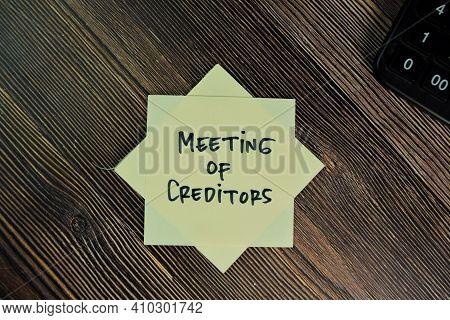 Meeting Of Creditors Write On Sticky Notes Isolated On Wooden Table.