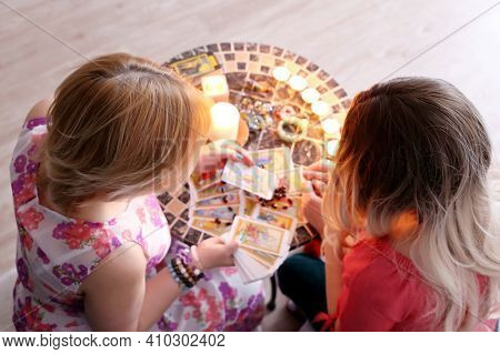 Fortune Telling Session, Seeing The Destiny And Astrology. Female Foreteller With Girl Client And Ta