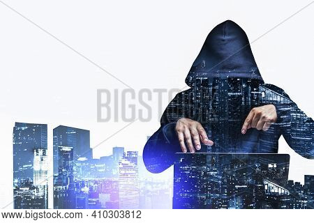Front View Of Hacker Attacking Confidential Information At Night. New York City On Background. Inter