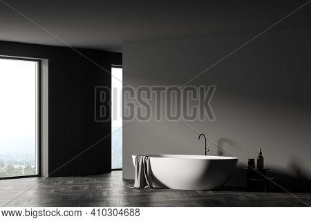 Modern Bathroom Interior With White Bathtub, Shampoo Table, Panoramic Window. Room Designed In Eco M