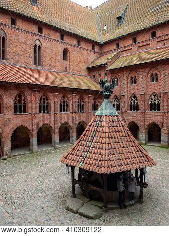 Malbork, Poland - Sept 8, 2020: Courtyard At Malbork Castle, Formerly Marienburg Castle, The Seat Of