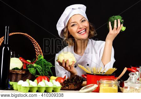 Smiling Female Chef With Broccoli. Healthy Food Preparation. Cooking In Restaurant. Dieting, Vegetar