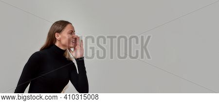 Lovely Young Caucasian Woman Dressed In Black Smiling Away And Telling Secret Sale Information, Posi