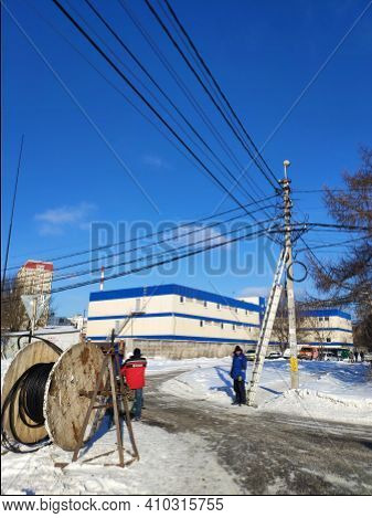 Moscow, Russia - 05 February 2020: Electricians Install Electricity On The Poles Of The Power Line.