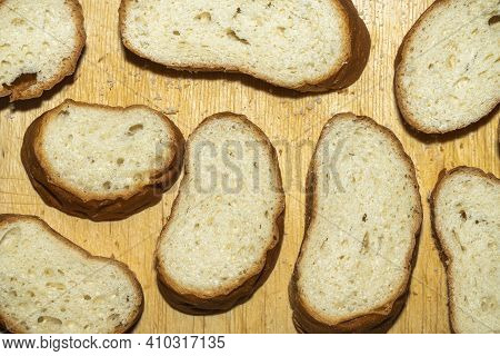 Breadcrumbs On A Wooden Background. Top View