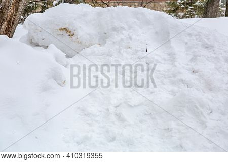 Pile Of Dirty Snow In A Winter Park