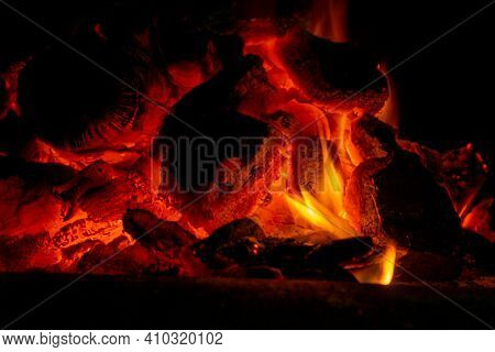 Incandescent Charcoal Ember In Orange And Yellow Tones. Heat Concept