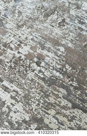 Background From A Stylish Carpet In Neutral Gray-beige Tones With Fading And Artificial Antiquity Ef