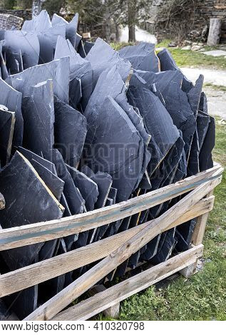 Slate Sheets On A Pallet, Building Material Ready To Make A House With Natural Materials, Black Arch