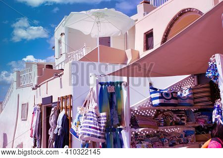 Santorini, Greece - September 11, 2017: One Of The Many Souvenir Shop With Bags Reflecting The Label
