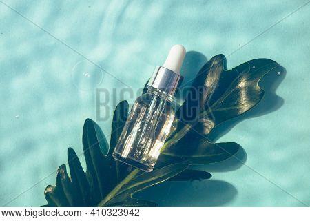 Serum Bottle Under Water. Cosmetic Product. Moisturizing, Reparing And Skincare.