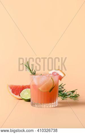 Grapefruit Soda With Lime Garnish Rosemary Sprig Isolated On Color Background. Mocktail Paloma. Clos