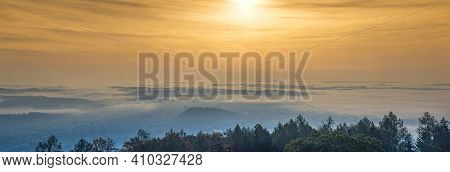 Amazing Foggy Sunrise Over The City Of Graz With Schlossberg Hill And Church Of The Sacred Heart Of