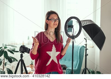 Young Woman Blogger Getting Ready To Shoot Video For Vlog, Backs