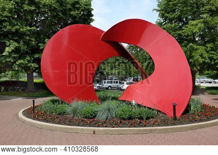 NAPERVILLE, ILLINOIS - MAY 26, 2017: Landforms Sculpture. The artwork by Jack Arnold is in the Naperville Riverwalk. The riverwalk follows the West Branch of the DuPage River.