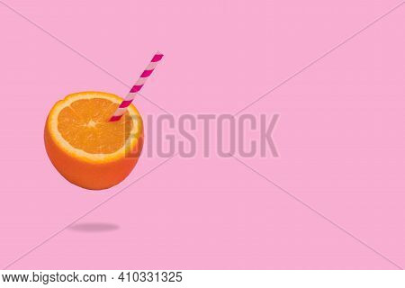 Creative Idea Of Fresh Fruit, Orange Half With Straw On Bright Pink Background.