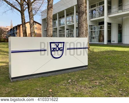 Zug, Switzerland - 26th February 2021 : V-zug Ag Company Sign In Front Of The Zugorama Building In Z