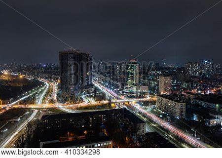 Aerial Panoramic Drone Above Roof View Of Kiev Night Traffic Road Junction Scene. Highway City At Ev