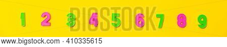 Numbers Set 1, 2, 3, 4, 5, 6, 7, 8, 9. Colorful Plastic Numerals Isolated On Yellow Background. Nume