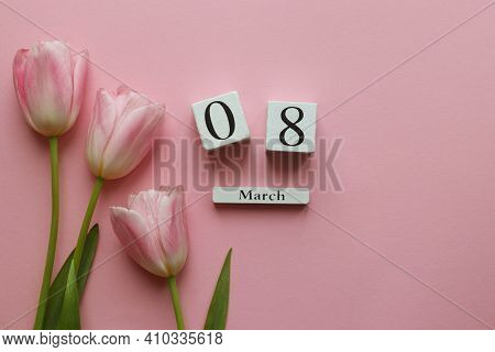 Womens Day Greeting Card. Wooden Calendar 08 March And Delicate Pink Tulip Flowers On Pink Backgroun