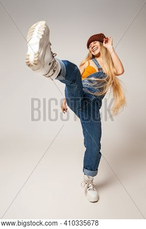 Cheerful Trendy Female Youngster Dancing In Studio