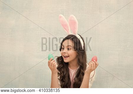 Girl Hunts For Easter Eggs. Happy Easter. Girl With Rabbit Ears And Eggs. Small Daughter Collect Pai