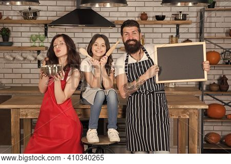 Baking Cookies. Culinary School. Mother Father And Daughter Cooking Together. Child With Parents Coo