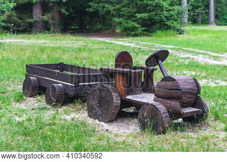 Wooden Tractor Made From Logs In The Playground.