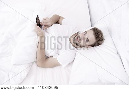 Provide Deeper Sleep Analysis. Set Up Morning Alarm. Apps That Help Monitor Sleep. Man Use Mobile Ph