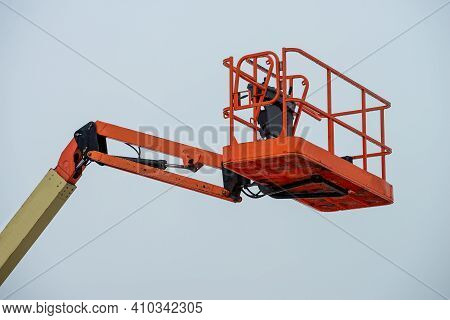 Red Hydraulic Construction Cradle Against The Sky Arm Tall