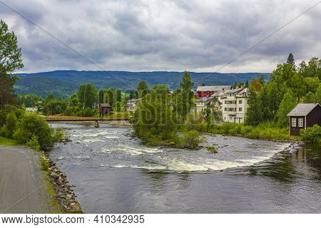 Idyllic Red Houses And River In Fagernes Fylke Innlandet Norway.