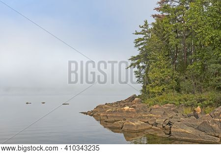 Morning Fog Lifting In The North Woods On Seagull Lake In The Boundary Waters In Minnesota