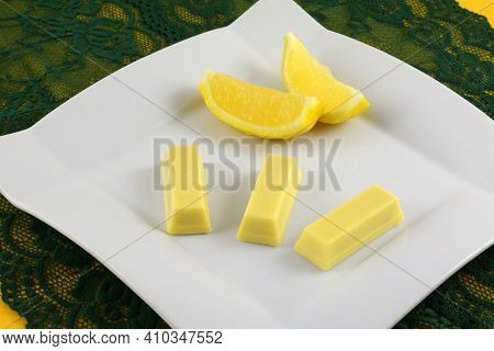 Lemon White Chocolate Wafer Snacks With Lemons On White Dessert Plate On Green Lace
