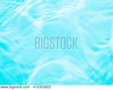 Ripple Water Texture On Blue Pool Background. Shadow Of Water On Sunlight. Mockup For Product, Spa O