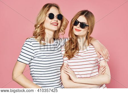 Two Female Friends In Sunglasses Hugs Companionship Friendship Lifestyle Pink Elephant