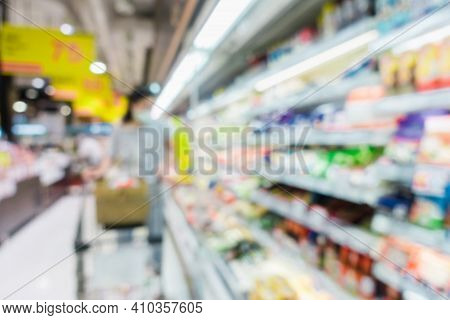 Abstract Defocused Blurred Of Consumer Goods And Shopping Cart In Supermarket Store, Shop Trolley Ba