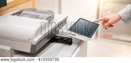 Male Hand Touching Button On Control Panel Of Photocopier Copying And Printing Report Paperwork In O