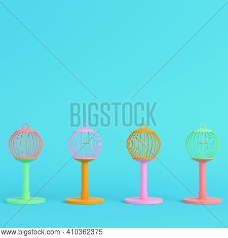 Colorful Bird Cages On Bright Blue Background In Pastel Colors. Minimalism Concept. 3d Render
