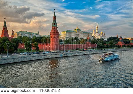View Of The Moscow Kremlin From The Moscow River. Red Brick Towers And Bell Tower Of Ivan The Great.