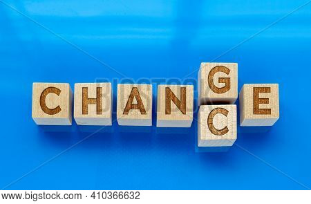 Top View Of Wooden Cubes With Word `change` To `chance` On Blue Background. Concept: Personal Develo